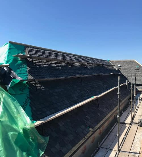 pitched roof being repaired