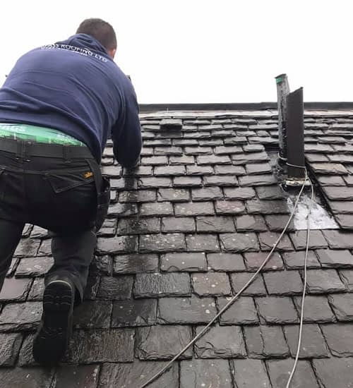 slate roof being repaired